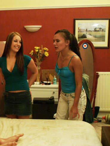 Absolutely naked guy is getting his dick worshipped by clothed Amanda Pickering and her friend