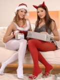Caroline Cage and Zafira in red and white pantyhose kissing on Christmas