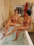 Anissa Kate and foot & legs lover Eva Parcker naked and together in a tub while teasing each other.