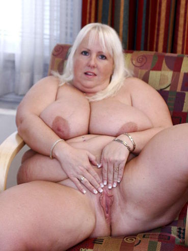 White haired fattie Daphne Stone removes her bra and panties to display her twat and monster tits