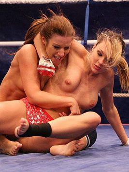 Lesbian fighters Debbie White and Blue Angel bare it all and have oral sex in the ring