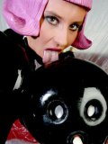 Kinky Peggy Sue and one more european latex girl playing with rubber doll