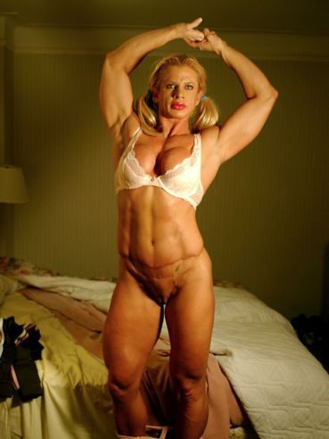 Lady bodybuilder Gabrielle Nicander removes her panties to show her amazing hairless pussy