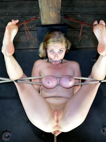 This bizarre gallery is featuring blonde cute darling Iona Grace who is into BDSM games.