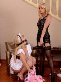 Big-ass Bonnie Spanks in a pink maid uniform getting punished and teased by Kathia Nobili.