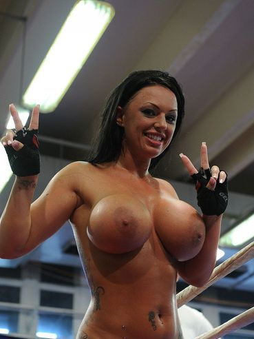 Kerry Louise with huge tits and her lesbian opponent get nude in the ring