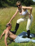 Mistress Lady Sonia rides the slave and tramples his body under the blue skies