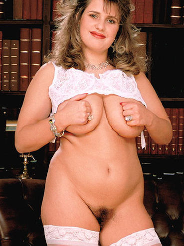 BBW Gabi in white stockings displays her bush and big sized natural breasts