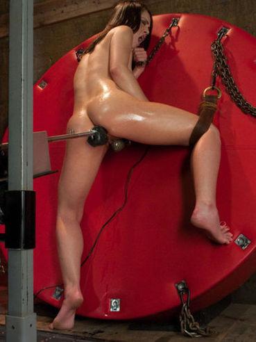 Fetish brunette model Kristina Rose is spreading her legs wide to take a dildo.