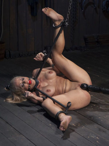 Holly Heart spanked and chained during hardcore bondage and while gagged her slit is teased.