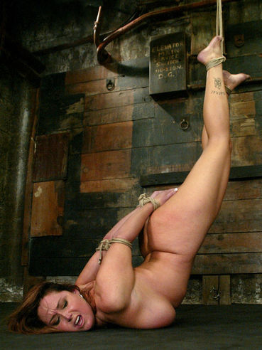 Busty milf Christina Carter gets her nice ass caned and her neat clit pumped before hogtie