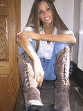 Charming Lori Anderson in white blouse blue, jeans and brown boots shows off her ultra long hair