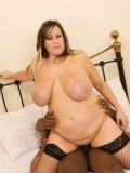 Sex obsessed big tit fattie Leah Jayne in black stockings has fun with chocolate cock