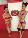 Lyla Storm makes this cat fight sexy when she rubs her sweaty body against her opponent.