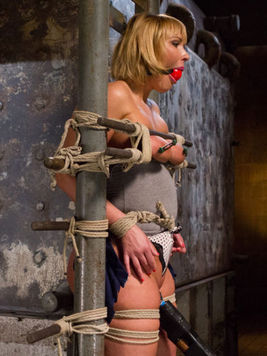 Mellanie Monroe gets hog ties and used up like a whore while her slit gets stimulated in bondage.