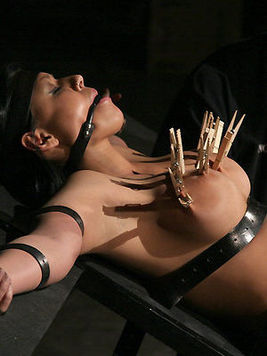 Eva Angelina is tied to bondage table and gets tortured with pegs and electricity for start
