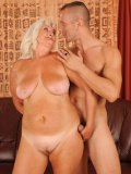 Tanlined mature blonde Judi with massive saggy tits gets banged by hot blooded boy