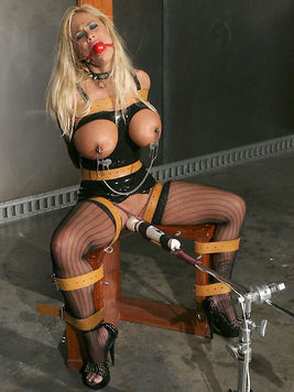 Latex loving slave blonde Shyla Stylez with monster tits enjoys the vibrator on a bondage chair