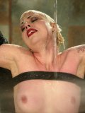 Naked caged blonde Lorelei Lee with hairless pussy gets water tortured by Viking