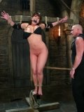 Master Mark Davis uses hot candle wax to punish pantyless slave Ava Devine