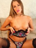 Long haired Lori Anderson poses in sexy lingerie and shows off her firm ass