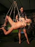 Blonde Angelic Diamond gets her smooth pussy fisted by Mandy Bright after rope suspension