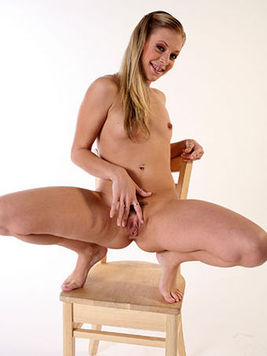 Leah Luv with beautifully shaved pussy rides on top of cock and squirts on a chair