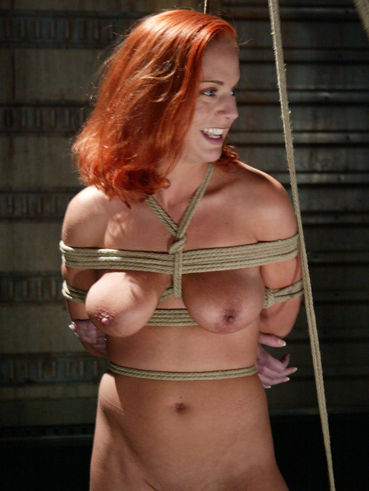 Busty redhead Gabriella Banks finds herself bound with ropes and getting face fucked by Mark Davis.