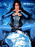 Latex babe Bianca Beauchamp touches her huge bare boobs on water filled rubber sofa bed