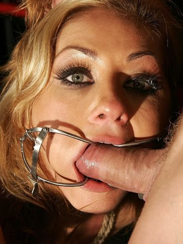 Greta gets her face fucked through mouth opener then finds master's cock inside her bald pussy