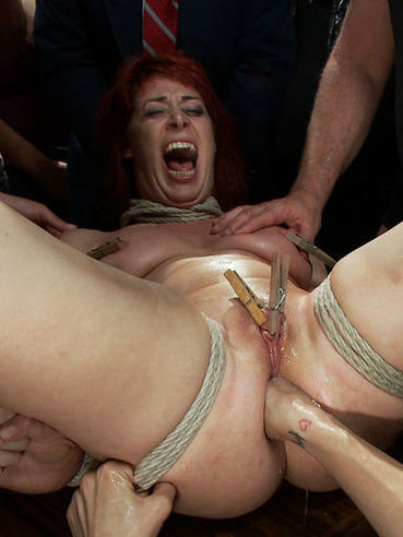 Hot redhead Odile gets her tight asshole and wet pussy fisted and then drilled hard and deep.