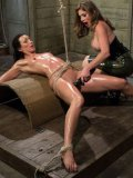 Felony and bondage babe Wenona oiled and tied up while stimulated with toys during lesbo bondage.