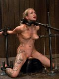 Rain DeGrey in a nasty and kinky looking contraption during her hardcore bondage scene.