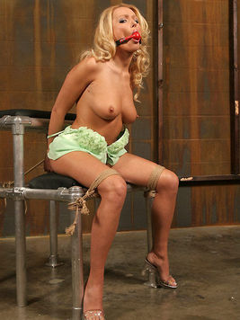 Rope bound blonde Diana Doll gets her shaved pussy vibrated from behind.
