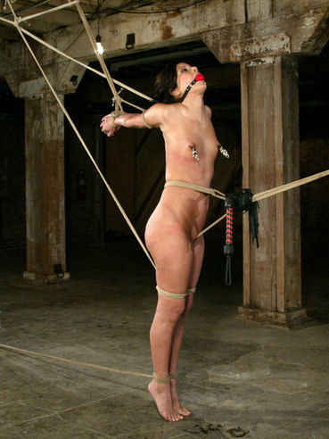 Sexy bodied tied brunette Gia Jordan gets slapped and caned by brutal man