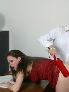 Bare ass Ann Marie in red mini skirt gets spanked by strict blonde