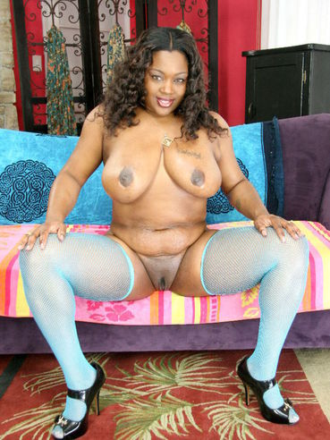 Big titted chocolate BBW chick Kim Eternity in blue stockings does striptease