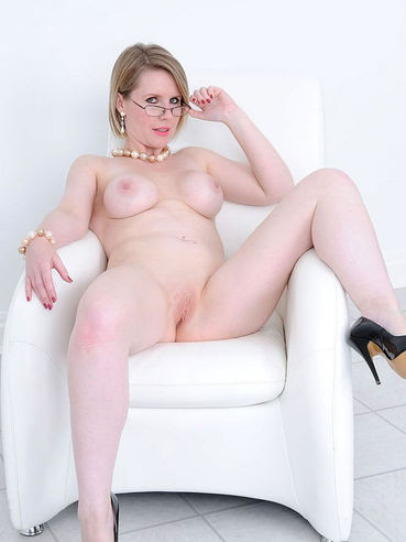 Naked spectacled mommy Angela shows off her totally smooth pussy and big boobs.
