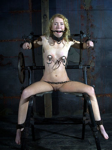 Fair-haired slave girl Nicki Blue dressed in black bares all in rope bondage