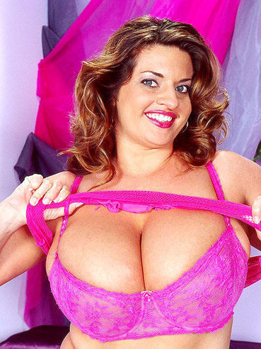 Smiley fattie Maria Moore dressed in pink pulls down her bra to show her bombs