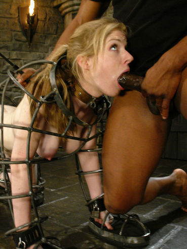 Caged pale skinned blonde Haley Scott gets fucked doggy style by black master JR Langdon
