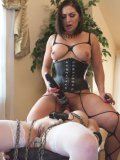 Bondage lover Katt Anomia poses then takes Lea Lexis into her hands and stimulates her.