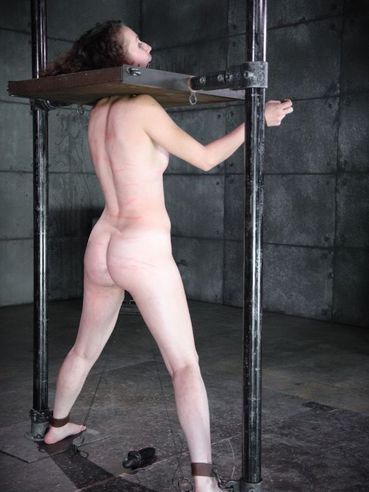Bonnie Day gets her pale body put into stocks while fetish lovers make her moan.