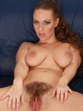 Naughty brown haired girl Luscious Eden with bushy pussy shows her pink hole