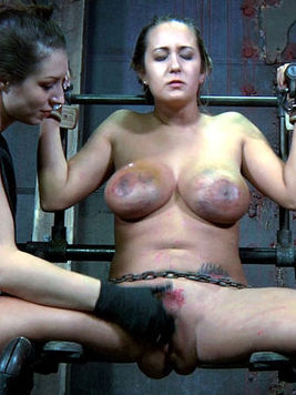 Big boobed slave brunette Trina Michaels gets hogtied before pussy torture