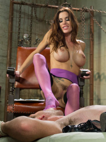 Busty brunette Gia DiMarco with huge melons and hairy pussy rides her slave's small dick wildly.