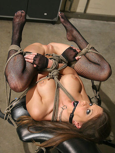 Babe in black stockings Rachel Roxxx is bound so that it was easy for her master to drill holes.