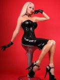 Elegant British blonde Saffron Taylor in tight black latex dress bares her boobs