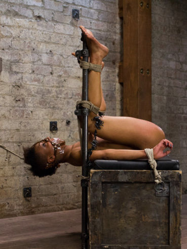 Famous ebony chick Nikki Darling with short hair gets gagged and tied up by her nasty mistress.