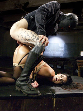 India Summer on her back while getting a throbbing cock shoved down her throat during rough BDSM.